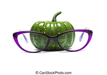 Green pumpkin in glasses isolated on white background