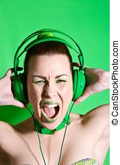 Green rage - Beautiful woman with headphones screaming very ...