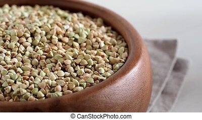 Green raw unroasted buckwheat slow motion
