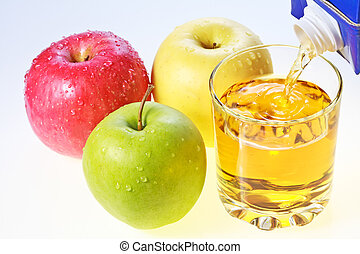 Green, red and yellow apples and glass of juice