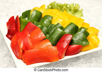 Green, red and yellow peppers