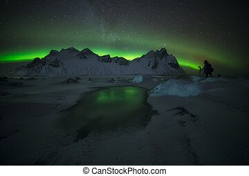 Green reflections in the snow in Stokkness, Iceland