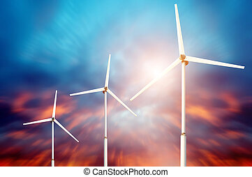 Green renewable energy concept - wind generator turbines in sky