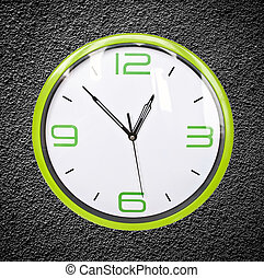 Green retro clock on black grunge wal