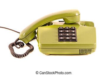 green retro telephone isolated on white background