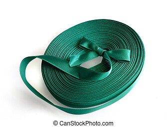 Green ribbon roll on a white background