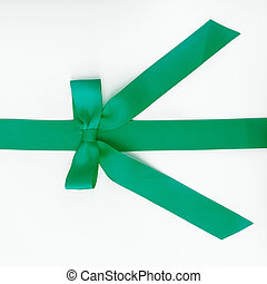 green ribbon with bow on white background.
