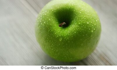 Green ripe apple with water drops - Closeup shot of green ...