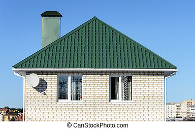 Green roof of white brick house - Top of the new white brick...