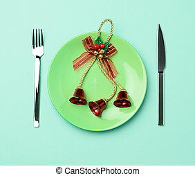 green round red ceramic plate, knife and fork