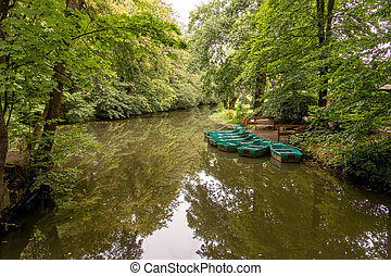 Green rowboats in the small lake
