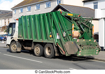 Green rubbish truck with boxes in the back.