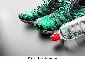 Green runners and a bottle