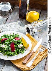 green salad with arugula beet and goat cheese, lemon, organic fo