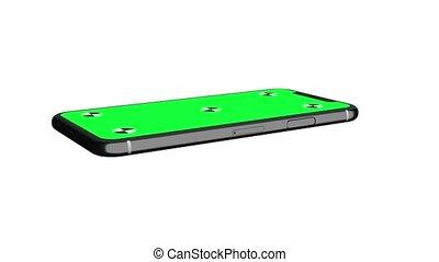 Green screen display of smartphone rotating in horizontal...