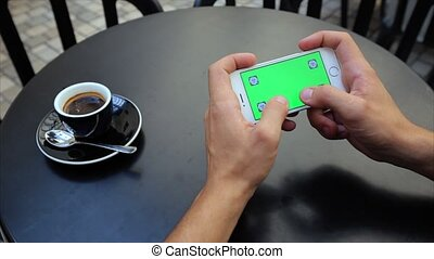 Green screen for typing text horizontally with both hands on the phone in white, Iphone, tags