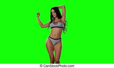 Green screen. Hot brunette girl dancing in bikini - Hot...