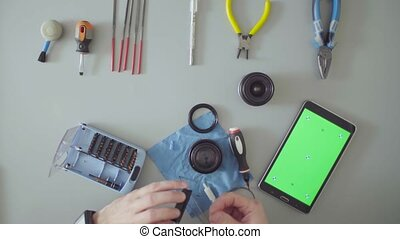 Green screen. Male hands greasing the lens - Top view. Male...
