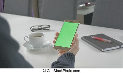 GREEN SCREEN man watching on his mobile phone