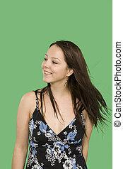 fashion shot of woman standing over green screen