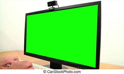 Green screen monitor and keyboard.