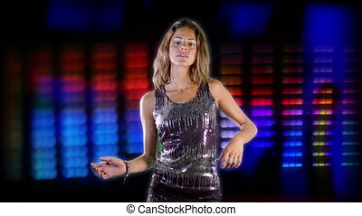 green screen of a sexy woman dancing in a sparkly disco dress, shot in high quality with the sony NEX-FS100. motino graphics of music equalisers used as background