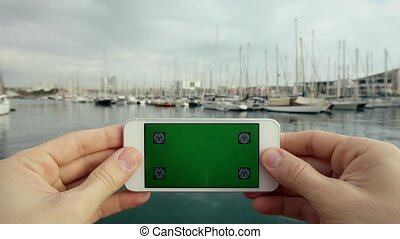 Green Screen Rotate Smart Phone Yachts in Harbour
