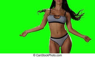 Green screen. Showing hot erotic dance girl in gray underwear
