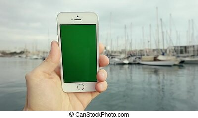 Green Screen Smart Phone Against With Yachts