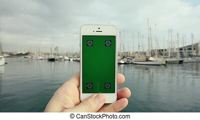 Green Screen Smart Phone in Passing Luxury Yachts