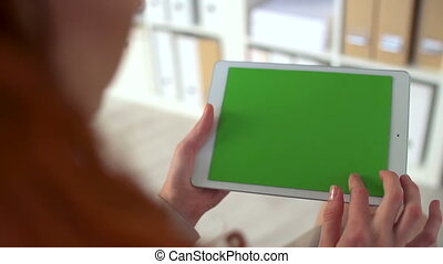 Green Screen - Over shoulder shot of unrecognizable woman...
