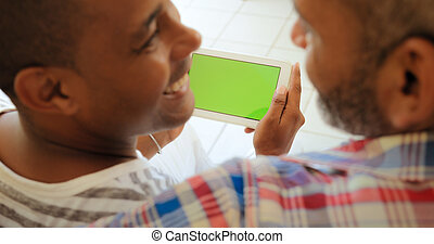 Green Screen Tablet Monitor With Gay Couple Using Internet