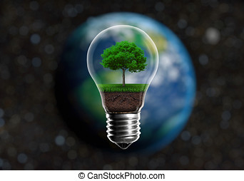 Green seedlings in a light bulb alternative energy concept, against a blurred background of planet Earth in space