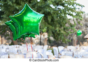 Green shiny balloons at garden table setting for wedding reception & Image of an unusual and pitoresque garden table setting. stock ...