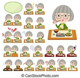 green shirt old women_Meal - A set of senior women about...