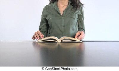 green shirt woman reading book 30