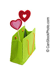 Green shopping bag with two red hearts isolated on white background