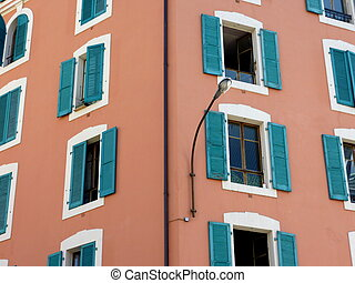 Green shutters on colored facade