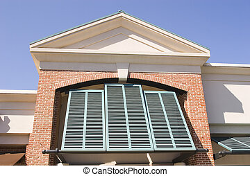 Green Shutters on Red Brick