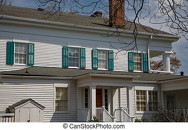 Green Shutters on White Wood House