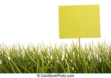 Green sign in the grass