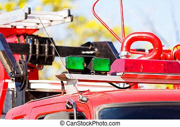 green siren on fire truck