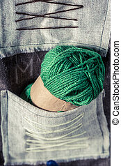 Green skein with yarn in tailor workshop