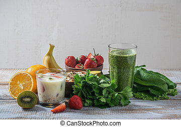 Green smoothie and muesli with fruits