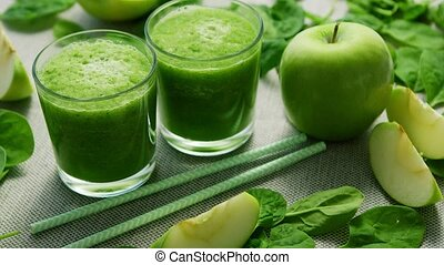 Green smoothie in glasses and ingredients - Layout of few...