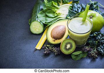 green smoothie ingredients on dark slate