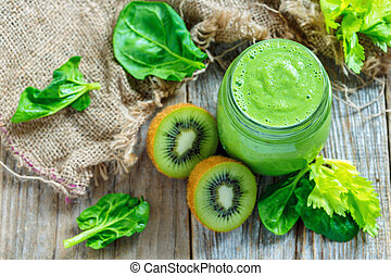 Green smoothie spinach, kiwi and celery in a glass jar.