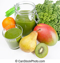 Green smoothie in a glass and in a open jar with fresh kale. A raw, healthy and vegan beverage made of green leafs and fruits.