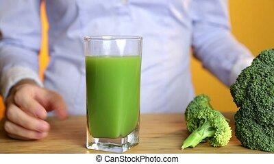 Green smoothie woman drinking healthy organic vegetable juice breakfast