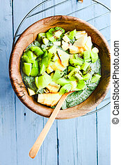 Green smoothies bowl with apple and kiwi, healthy raw breakfast